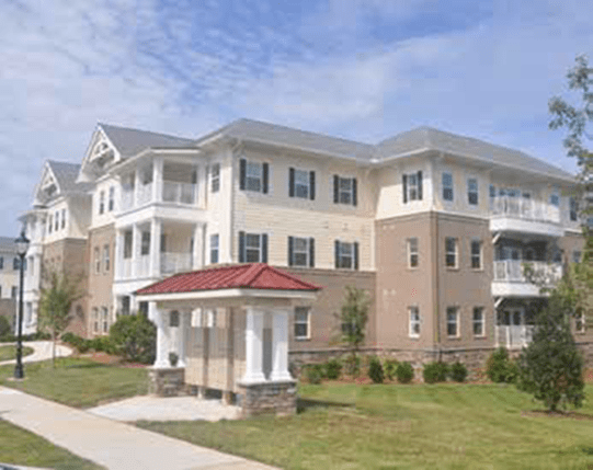 view of the exterior of the one of The Village at Matthews Glen's residential buildings